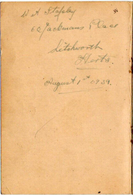 Inside front leaf of a notebook with a name and address