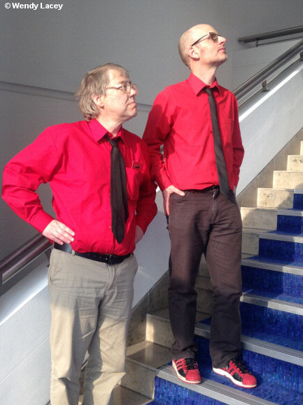 Photo of two men posing as robots on a staircase