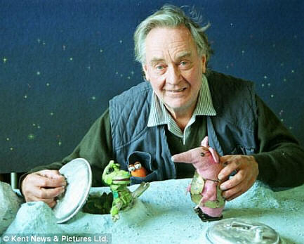 Photo of Oliver Postgate with a Clanger