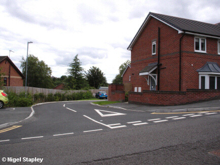 Photo of the entrance to a small housing estate